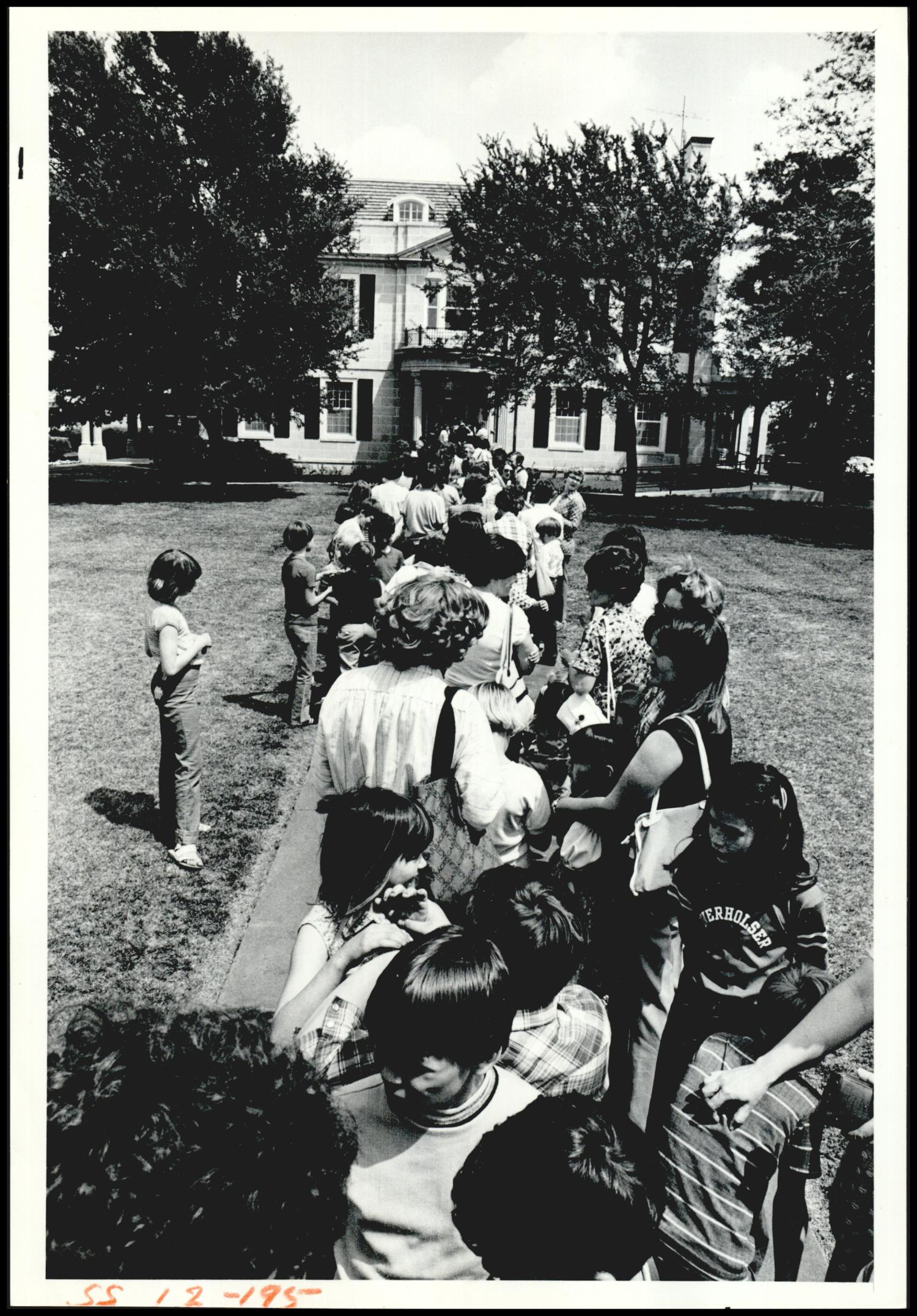 Youngsters line up for a tour of the Governor's Mansion - 1980s